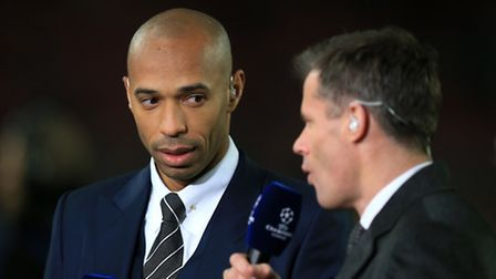 Sky Sports pundit Thierry Henry (left) listens to Jamie Carragher. Pictrue: Mike Egerton