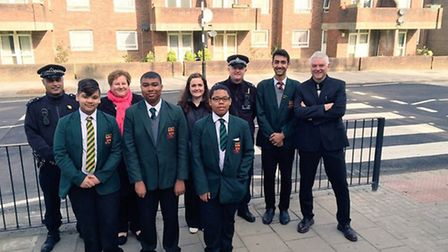 Pupils, staff and safer school police officers from Newman Catholic College trying out the new cros