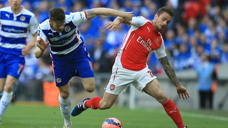 Reading's Jamie Mackie, (left) battles for possession with Arsenal's Mathieu Debuchy
