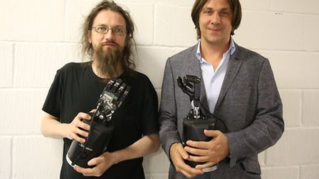 Inventor Mark Oleynik and Rich Walker from Shadow Robot Company with the robotic arms used for the r
