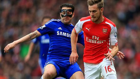 Chelsea's Cesc Fabregas (left) and Arsenal's Aaron Ramsey in action at Emirates Stadium