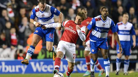 Arsenal's Andrey Arshavin (centre) and Reading's Noel Hunt (left) battle for the ball in 2012's extr