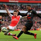 Arsenal's Hector Bellerin (left) and Liverpool's Raheem Sterling in action during the Barclays Premi