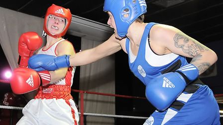 Islington's Rachel Holifield (left) in action against Army boxer Megan Reid at the Boston Dome, Tufn