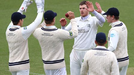 James Harris of Middlesex is congratulated on the wicket of Essex's James Foster during their pre-se
