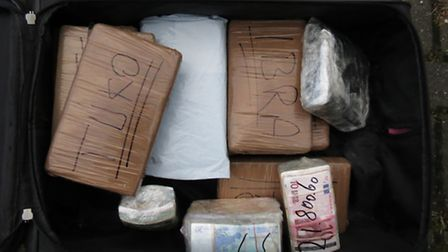 Drugs and cash in a suitcase (Pic credit: National Crime Agency)