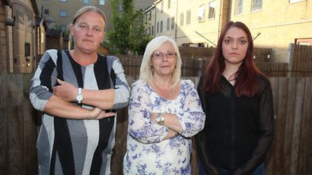 Lisa Lovelock with neighbours Charlie Moir and Shirley Moir who have been terrorised by a massive, v