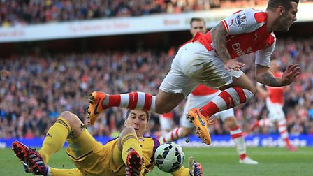 Sunderland goalkeeper Costel Pantilimon (left) claims the ball ahead of Arsenal's Jack Wilshere