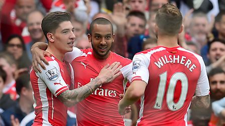 Arsenal's Theo Walcott (centre) celebrates scoring his side's second goal against West Brom with tea
