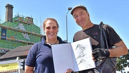 Katy Runacres, left, with street artist ATM, planned the mural trail in Lowestoft. Photo: Mick Howes