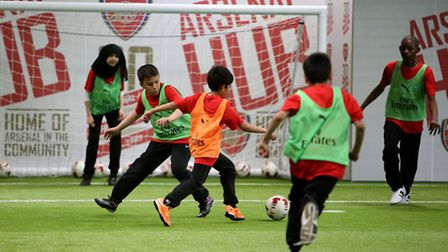 The Crest Academys Year seven boys and Year nine and ten boys and girls playing football at Arsenal