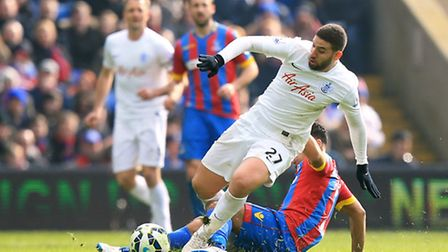 Crystal Palace's Adrian Mariappa (right) and Queens Park Rangers' Adel Taarabt (left) battle for the