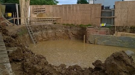 A dug hole has filled with water following the burst water pipe (Pic credit: Ian Hobbs)