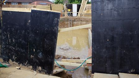 Bush Grove was flooded when a water mains burst while builders were excavating a basement