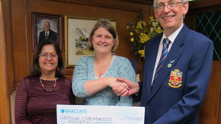 Renu Simmonds, Stella Scriver and John Bennett with the �7, 000 cheque from Sudbury Golf Club to the