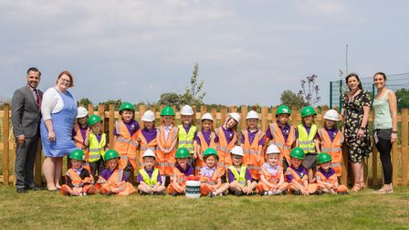 Children from The Limes Primary Academy prepare to bury a time capsule with (from left) Persimmon Ho