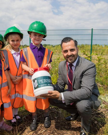 Persimmon Homes Anglia field sales manager Jorden Knell helps children from The Limes Primary Academ