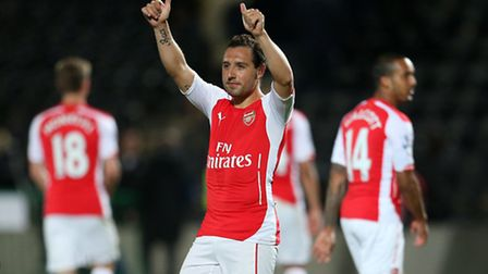 Arsenal's Santi Cazorla gives the thumbs up to fans after the Barclays Premier League match at the K