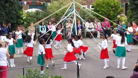 Maypole dancers at the Church of the Ascension May Fair