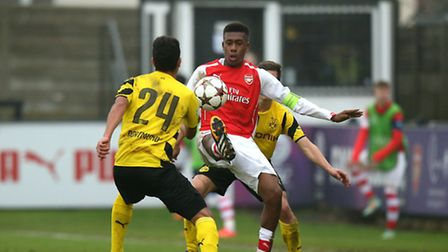 Arsenal's Alex Iwobi, (right) is tackled by Borussia Dortmund's Hayrulla Alici, (left). Picture: Joh