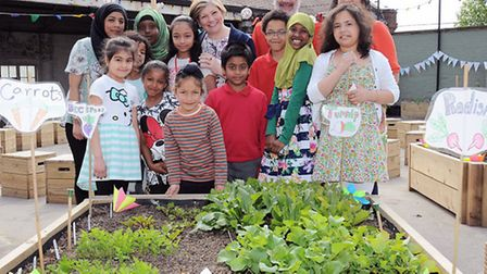 Emily Thonberry, Cllr Richard Greening and Harsha Patel with pupils at Copenhagen Primary School - D