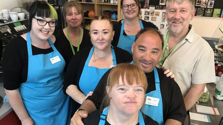Service with a smile. Staff at Compass Cafe, based in Lowestoft library, where workers with learning