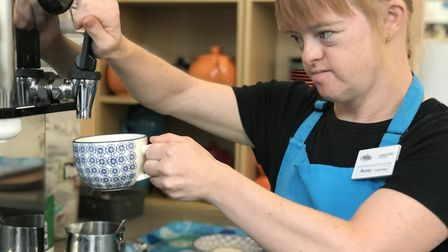 Bernie McDonald who has Down Syndrome is the expert coffee maker at Compass Cafe in Lowestoft. Pictu