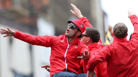 Jack Wilshere celebrates winning the FA Cup during their parade through Islington. Scott Heavey/PA W