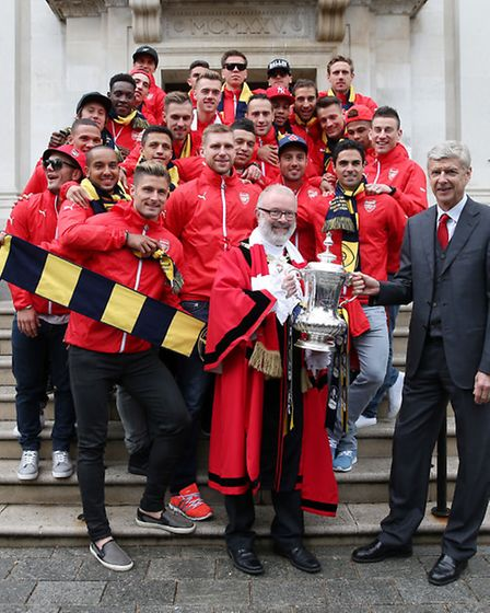 The Arsenal team celebrate winning the FA Cup during their parade through Islington. Photo: Scott He
