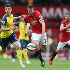 Manchester United's Robin van Persie (right) and Arsenal's Laurent Koscielny