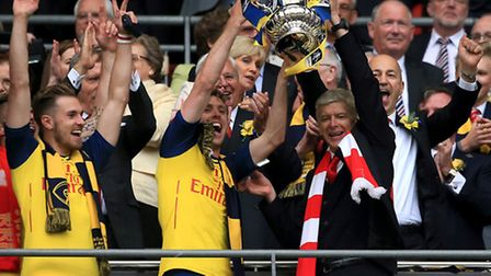 Arsenal's Nacho Monreal (centre left) and manager Arsene Wenger (centre right) celebrate with the FA