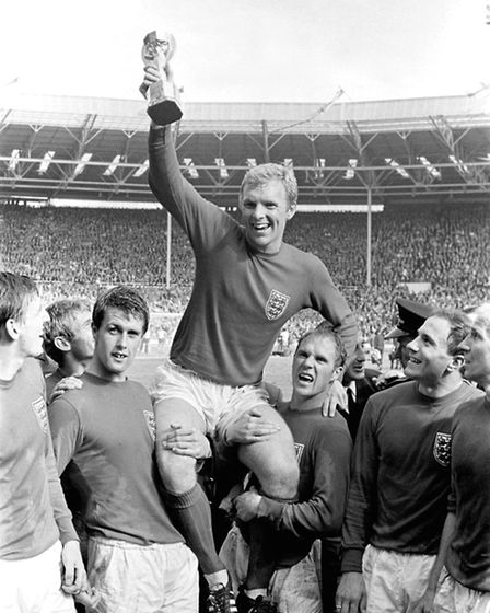England's triumphant 1966 World Cup final captain Bobby Moore chaired by hat-trick hero Geoff Hurst