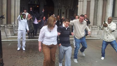 Sam Hallam and his mother were drenched with champagne as they left the High Court