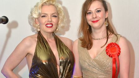 Harriet Hutton, from Islington, poses with 'Marilyn Monroe' at a special prom event
