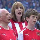 Peter Gosnell (left) and his grandson Edwin sing their hearts out at Wembley