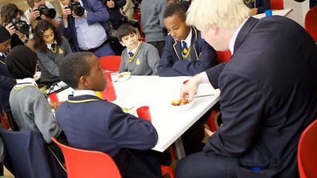 Mr Johnson enjoys a healthy snack with pupils (Pic credit: Adam Thomas)