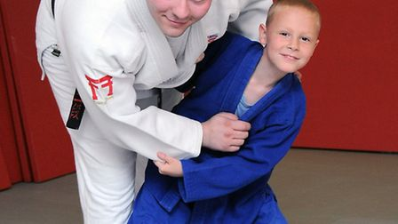Judo instructor Ryan Gordon coaches nine-year-old Harry Woolven at his first class at EC1 Judo Zone