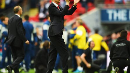 Arsene Wenger manager of Arsenal celebrates following the FA Cup Final (Photo by Shaun Botterill/Ge