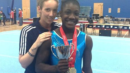 Islington gymnast Tomique Gibson (right) with coach Michelle Guiseris