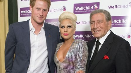 Prince Harry meets with Lady Gaga and Tony Bennett as he attends a Well Child Charity concert at the