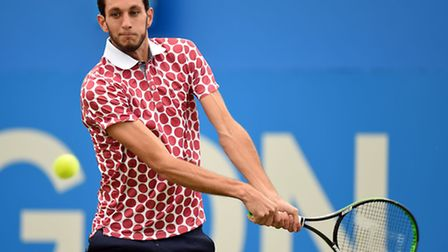 James Ward in action during his first-round defeat at The Queen's Club