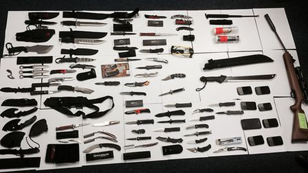 The cache of 62 knives was uncovered in the boot of a car on Monday afternoon