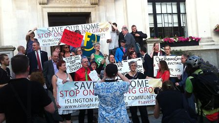 Residents protest outside the town hall on Thursday