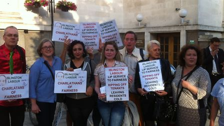 Central heating campaigners outside the town hall before the meeting
