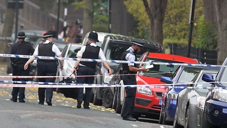 Police at the scene in Shepperton Road. Pic: John Stillwell/PA Wire