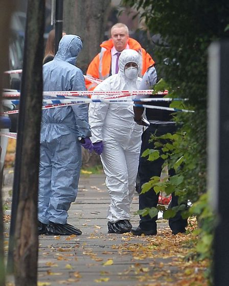 Forensics officers at the scene. Pic: John Stillwell/PA Wire