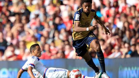 Arsenal's Chuba Akpom (right) and Lyon's Mehdi Zeffane battle for the ball during the Emirates Cup
