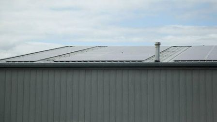 Solar panels on the roof of Rustins paint factory in Neasden