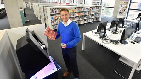 Cllr James Denselow becaome the library's first customer (Pic credit: Brent Council)