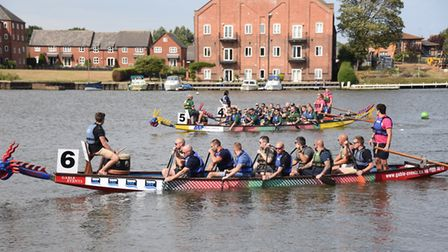 Boats line up at the race start at the East Anglian Dragon Boat festival at Oulton Broad. Picture: D